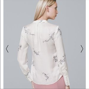 WHBM white blouse with black floral pattern